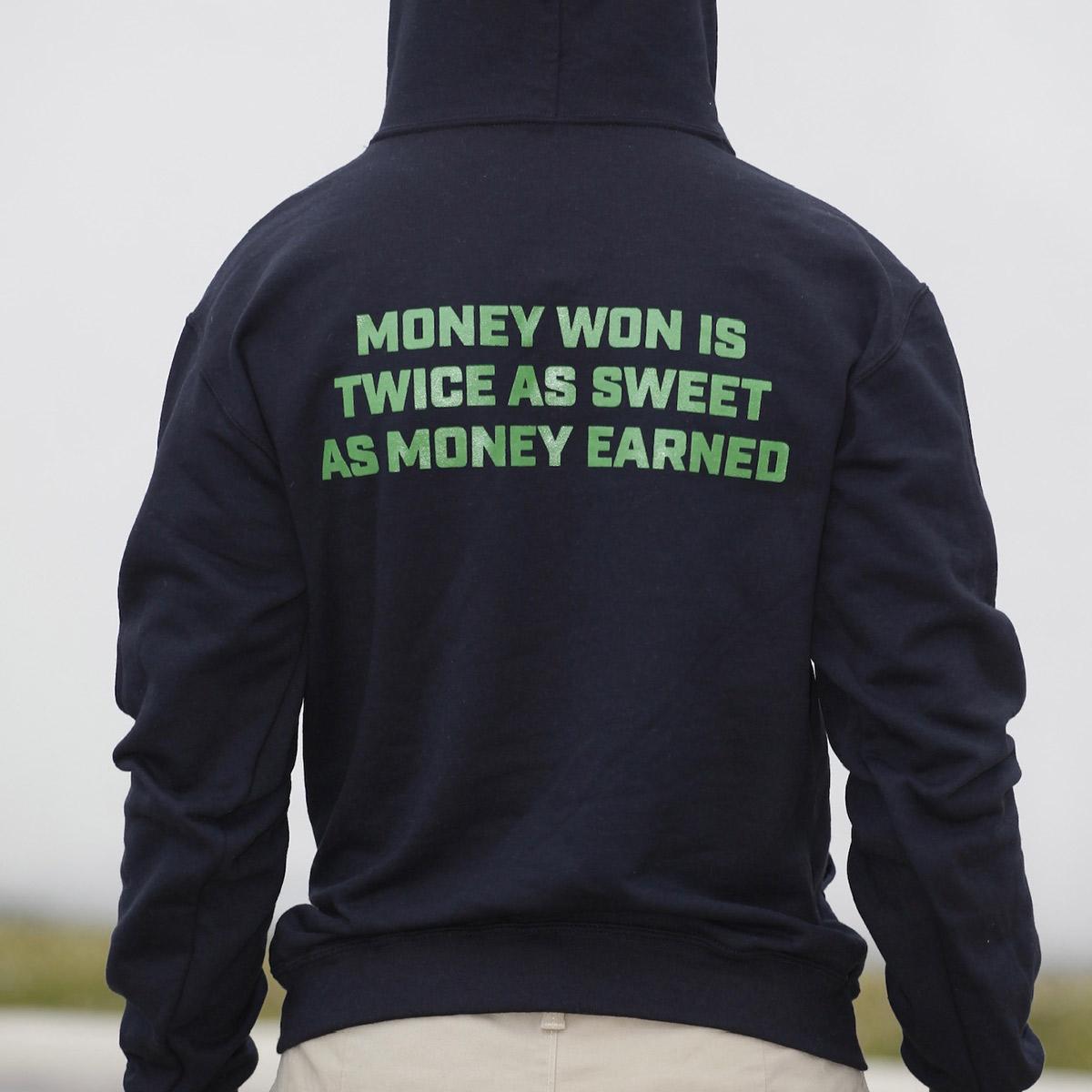 Money won is twice as sweet as money earned - black hooded sweatshirt - back